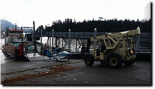 20150728_094142-Damaged amphibious plane with wings removed for transport.jpg